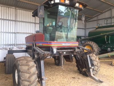 Photo 1. MacDon 9350 Windrower
