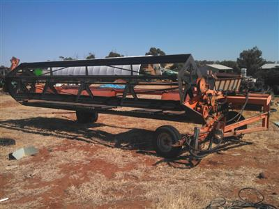 Photo 1. Agware 21ft tow behind windrower