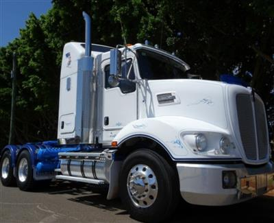 Photo 1. Kenworth T403 prime mover