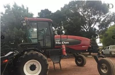 Photo 1. MacDon M150 windrower