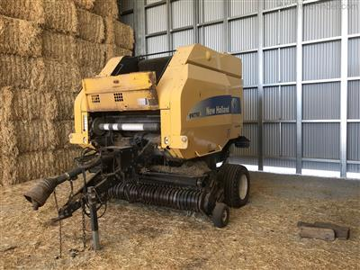 Photo 1. NEW HOLLAND BR750A round baler