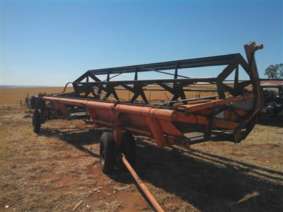 Photo 2. Agware 21ft tow behind windrower