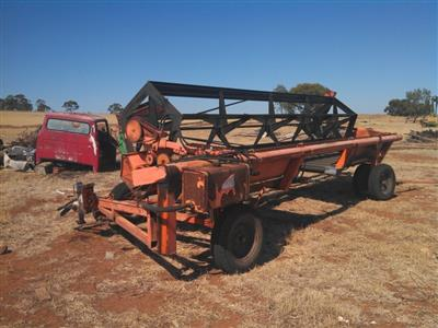Photo 3. Agware 21ft tow behind windrower